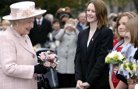 CLOSE ENCOUNTER: youngsters meeting the Queen on her arrival. Pictures: MATTHEW READING