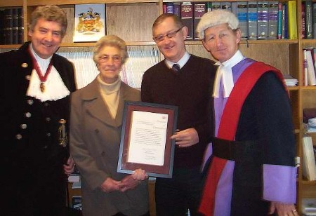 BRAVE MAN: Brian Beesley, centre right, with his mother, the High Sheriff Nigel Wheeler, and Judge Jeremy Carey. Picture courtesy MAUREEN UTTING