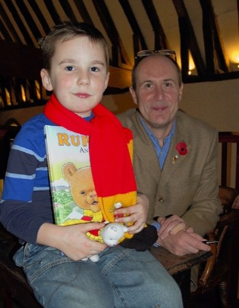 Young Rupert fan Joshua Wiseman, four, meets the new illustrator of the annual, Stuart Trotter