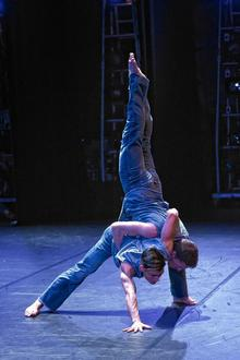Two of the BalletBoyz dancers practising contemporary ballet moves.