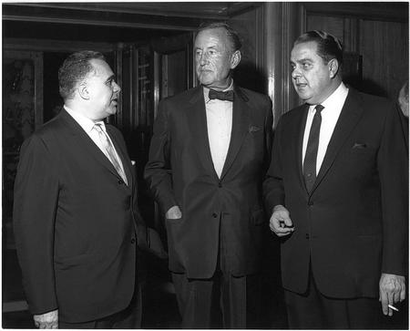 Harry Saltman, right, Ian Fleming and Cubby Broccoli pose for a photo after signing their agreement to produce the first James Bond film in 1962, taken from Bond on Bond by Roger Moore. Copyright: 1962-2012 Danjaq LLC and United Artists Corporation