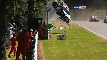 Marshals run for their lives at Brands Hatch race track after Francisco Carvalho­s car flew out of control and flipped over crash barriers.