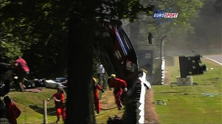 Marshals run away as driver Francisco Carvalhos car crashes at Brands Hatch racing circuit.