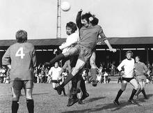 Les Burns in the white shirt going up for a header during the 1971-72 FA Cup tie, Dartford v Walton & Hersham
