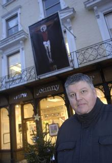 John Cotter outside his gallery with the Beckam painting