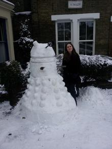 13-year-old Daisy Fry with her snow Dalek in Forbes Road, Faversham.