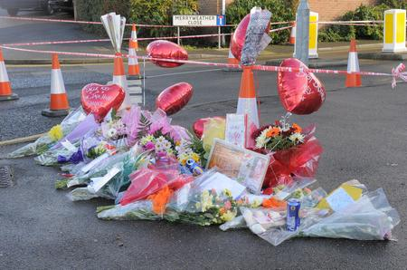 Floral tributes at the scene of a shooting that killed Kevin Mckinley in Dartford