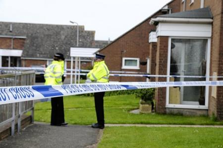 A police cordon around the house in Prescott Close, Guston