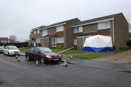A police car, tape and a police tent outside the property under investigation in Farncombe Way, Whitfield.