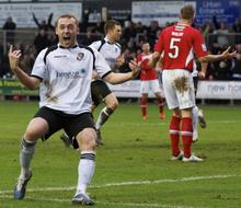 Harry Crawford enjoys the moment after his equaliser for Darts