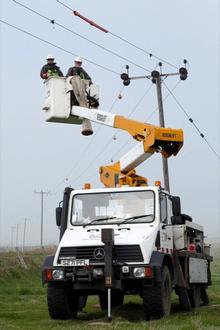 UK Power Networks engineers fitting diverters to power lines