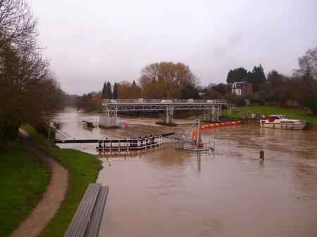 The lock at East Farleigh almost disappears under the high river.
