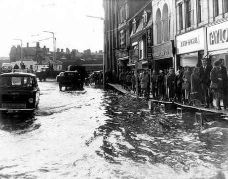 Floods hit Maidstone high street in 1953.