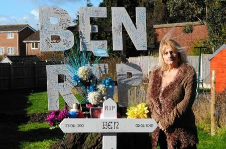 Ben's mum Ruth Jayes pictured with the memorial to her son in her garden.