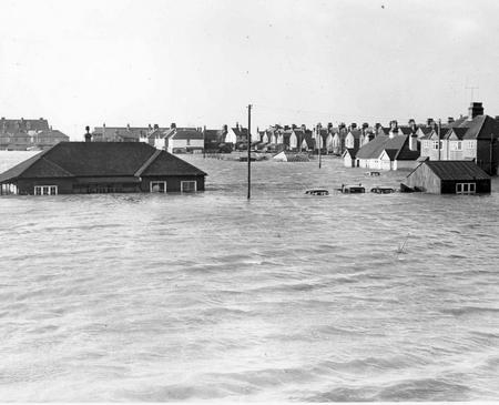 Cars left outside Whitstable Golf Club were nearly submerged by the rush of water. pic dated 1953.