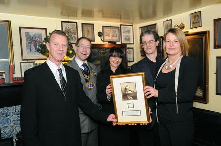 Presentation to Leather Bottle pub in Cobham of a strand of Charles Dickens' hair. L/R, Bryan Treleaven - landlord, Medway Mayor - Vaughan Hewett, Sara Saunders - pub manager, Ian Rons who won the hair, Susan Treleaven - landlady.
