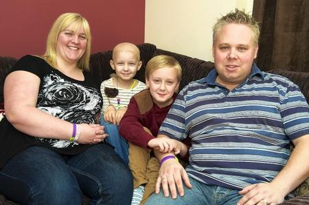 Samantha and warren Mowle, with Stacey, 7, and Jake, 9. Stacey has neuroblastoma, and the family is raising £500k for treatment.