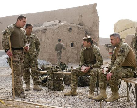 Major Shane Burton the Officer Commanding B Company briefs Brigadier Bob Bruce Commander of 4 Mechanized Brigade on the local area and how the Afghan Uniformed Police will maintain security once the base has closed.
