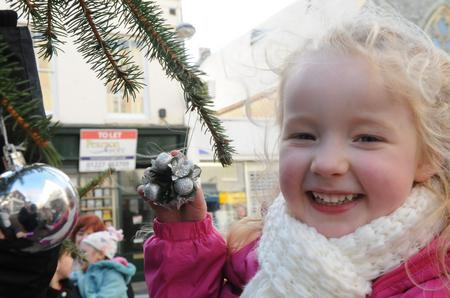 Grace Walker, five, lends a hand with the decorations