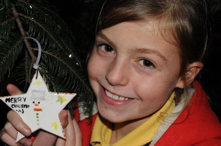 Bella Daly, nine, from Reculver, was among those to decorate the tree