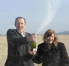 Hythe angler Ron Warne and wife Sue celebrating a £1million EuroMillions win