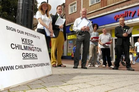 Campaigners against Chilmington Green development petitioning for signatures in the High Street. Ashford Town Centre.