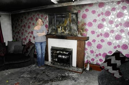 Amanda McLaren in her living room and the blackened surrounds in Willesborough.