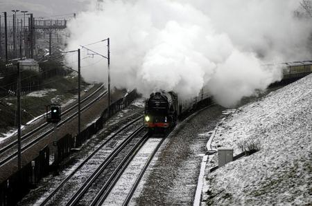 Tornado, an A1 class steam engine speeds past a quiet high speed line near the Channel Tunnel