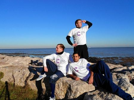 James Kent, standing, Steven Bond, left, and Cymon Williams are hoping to set off on a series of sporting challenges for Cancer Research UK