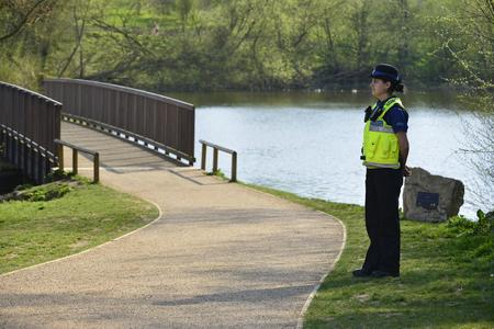 Police at the scene where a body was pull from Mote Park lake