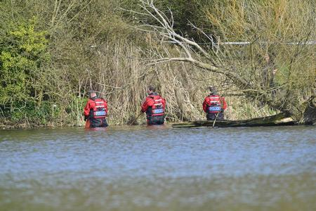 Officers search Mote Park lake this afternoon. Picture by Martin Apps