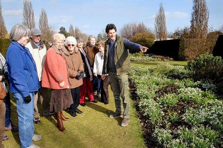 Hadlow College head gardener Alex Rennie shows visitors around the gardens during the Hellebore Open Days. Picture by Matthew Walker