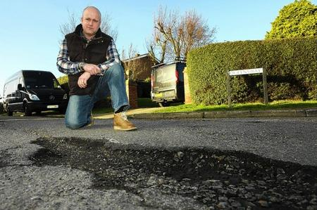 David Wiggens, beside the large pothole at the junction of Avery Way and Queensway, Allhallows. He has been fighting to get this repaired for over three years after he fell in it, damaging his knee.