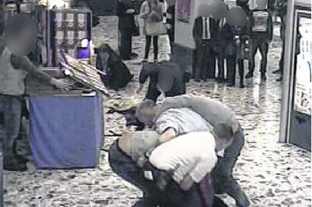 The brawl develops in front of CCTV cameras at the Mall Chequers