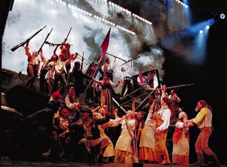 A cast scene from the stage show Les Miserables at The Shaftesbury Theatre, London