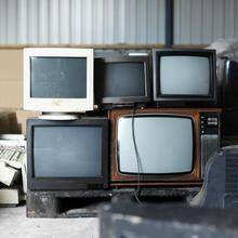Old TV screens and computer monitors. Picture: George Doyle