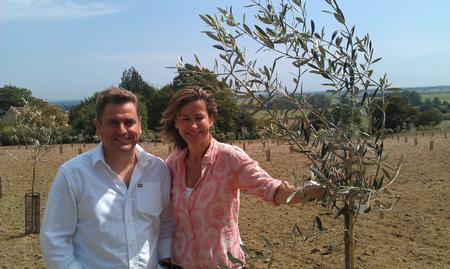 Neil Davy and his wife Louise at their olive grove in Stone-in-Oxney.