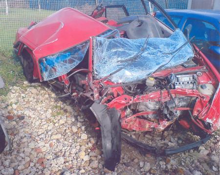 The mangled wreckage of Jan McKenzie's Audi 80