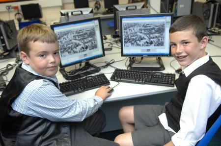 Year 4 pupils Luke and James using the KM Group's digital archive
