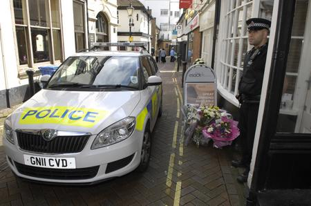 Police cordon off Natalie Esack's salon in Ashford High Street after she is stabbed to death