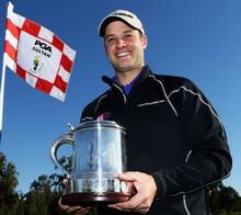 Walmer & Kingsdown golfer RichardWallis after defending his Titleist PGA Play-off title