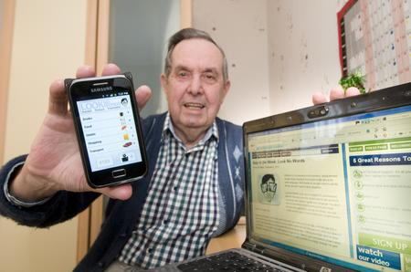 Teynham pensioner Bryan Speller with his smartphone app