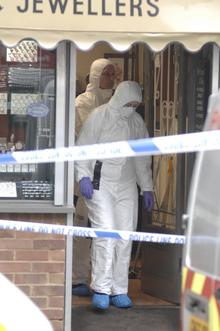 Forensic officers at Battrum & Son Jewellers in Sittingbourne High Street