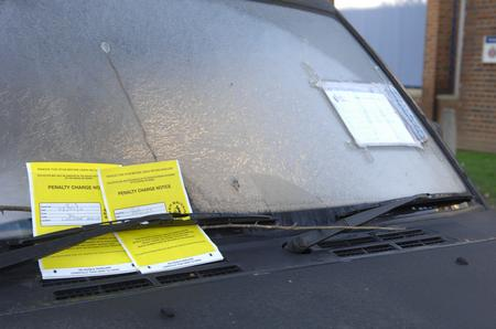 The parking tickets on the car left outside Sittingbourne police station despite a police note to say the owner has been taken to hospital