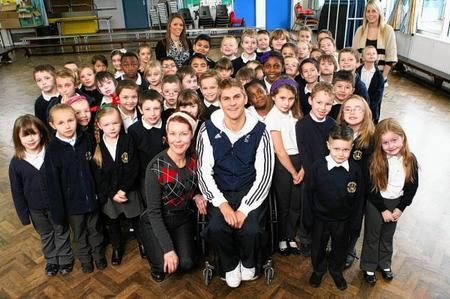 Paralympic wheelchair rugby captain Steve Brown visited Regis Manor Primary School to give a talk to pupils. He is pictured with Year 3 children and Beat Project artist Nikki Dennington