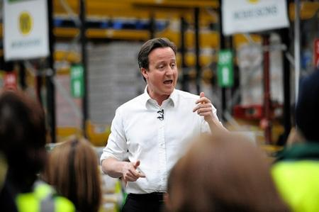 Opposition leader David Cameron talks to workers at Morrisons' distribution depot at Sittingbourne