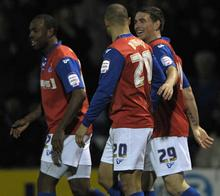 Cody McDonald celebrates his goal against Northampton