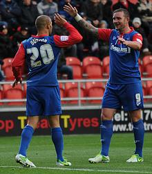 Deon Burton celebrates his opening goal against Rotherham