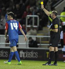Charlie Allen is given a yellow card against Rotherham