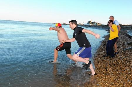Members of Sheerness Swimming Club and Lifeguard Corps take to the chilly seas